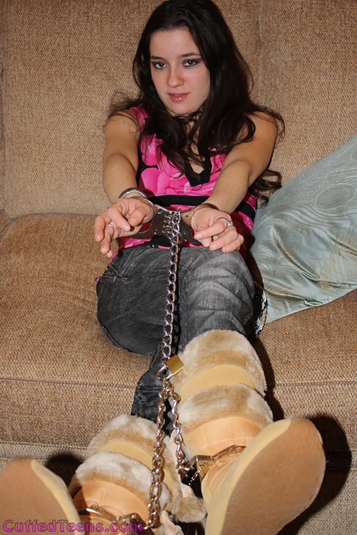 Kayla in hinged handcuffs