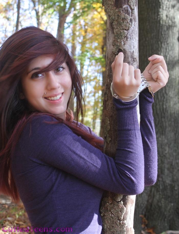 Cera cuffed to a tree